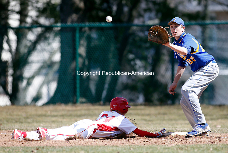Seymour, CT- 11 April 2015-041115CM14-  Seymour's Tyler Sirowich waits for the throw from pitcher Mike Tacinelli to hold Wolcott's Ray Bartoli at first  during their NVL matchup against on Saturday. Bartoli was called safe.   Christopher Massa Republican-American