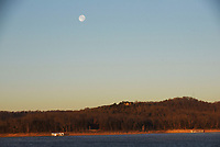 NWA Democrat-Gazette/FLIP PUTTHOFF<br />SUN RISE, MOON SET<br />A nearly full moon sets on Wednesday Jan. 3 2017 as the sun rises over Beaver Lake in the Rocky Branch area. The full moon was Jan. 1 and 2. A second full moon this month, or a Blue Moon, will occur on Jan. 31.