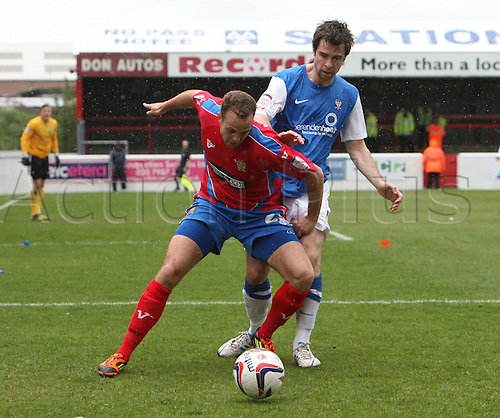 27.04.2013 Dagenham, England. Brian Woodall of Dagenham & Redbridge and David McGurk of York City during the League Two game between Dagenham & Redbridge and York City from Victoria Road.