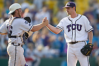 TCU catcher Bryan Holaday shakes the hand of TCU pitcher Tyler Lockwood after winning in Game 11 of the NCAA Division One Men's College World Series on June 25th, 2010 at Johnny Rosenblatt Stadium in Omaha, Nebraska.  (Photo by Andrew Woolley / Four Seam Images)