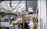 March, 1995, Kamikuisshiki Mura, Japan - Police confiscate explosives, chemical weapons and biological warfare agents during a raid on Aum's facility - No. 7 Satyam - on the foot of Mt. Fuji in March 1995. On the morning of 20 March 1995, cult members released sarin in a coordinated attack on five trains in the Tokyo subway system, killing 13 commuters, seriously injuring 54 and affecting 980 more. Some estimates claim as many as 6,000 people were injured by the sarin. (Photo by Haruyoshi Yamaguchi/AFLO)