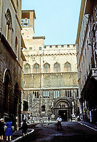 Italy: Perugia--looking to Priors' Palace from side street. The Palazzo Dei Priori from the Via Cesare Fani. Photo '83.