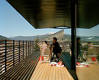 Architect Ulla Hell with one of her three daughters on the balcony of her modern chalet