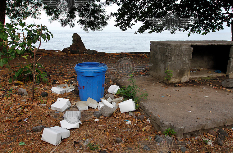 Lunch boxes strewn around a garbage container on a beach in Tulamben on Bali's North coast. The spot is a popular dive site and many tourists come to see the underwater beauty of nearby reefs. Yet they don't always clean up after themselves.