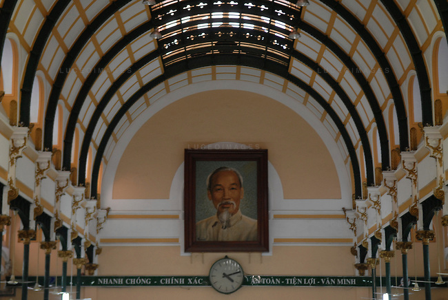 A portrait of Ho Chi Minh is displayed at the Post Office in Ho Chi Minh City, Vietnam.