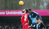 Aaron Pierre of Wycombe Wanderers beats Ollie Palmer of Leyton Orient in the air during the Sky Bet League 2 match between Wycombe Wanderers and Leyton Orient at Adams Park, High Wycombe, England on 23 January 2016. Photo by Andy Rowland / PRiME Media Images.