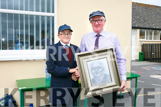 6th class pupil William McMahon present a portrait of  Principal John McAuliffe of LIXNAW Boys School, on his retirement on Tuesday
