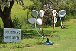 Politician's wind wheel made of old bed pans along Kansas' Republican River