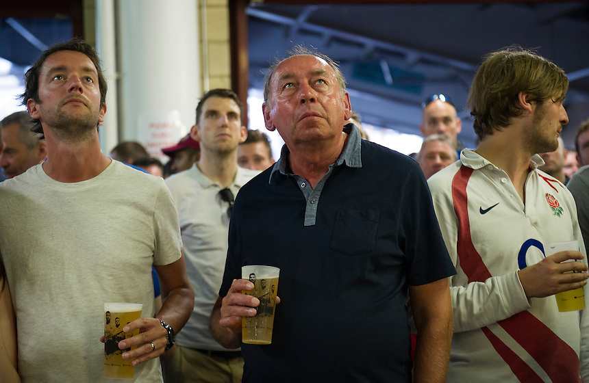 Fans watching the TV screens during the rain break<br /> <br /> Photographer Ashley Western/CameraSport<br /> <br /> International Cricket - Investec Ashes Test Series 2015 - Fifth Test - England v Australia - Day 4 - Sunday 23rd August 2015 - Kennington Oval - London<br /> <br /> &copy; CameraSport - 43 Linden Ave. Countesthorpe. Leicester. England. LE8 5PG - Tel: +44 (0) 116 277 4147 - admin@camerasport.com - www.camerasport.com