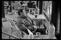 A lone Chinese man enjoys tea at a teahouse at the People's Park in Chengdu, capital city of the southwestern province of Sichuan, in March, 2011.  .