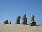 Fingers in the sand reach up on this beach in Punta del Este, Uruguay