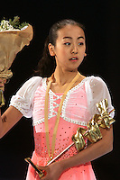 November 19, 2005; Paris, France; Figure skating star MAO ASADA of Japan celebrates gold medal win in ladies figure skating at Trophee Eric Bompard, ISU Paris Grand Prix competition.  Asada is just 15 years old and not eligible for the Torino 2006 Olympics, yet still a bright hope in Japanese figure skating for championships.<br />Mandatory Credit: Tom Theobald/<br />Copyright 2005 Tom Theobald