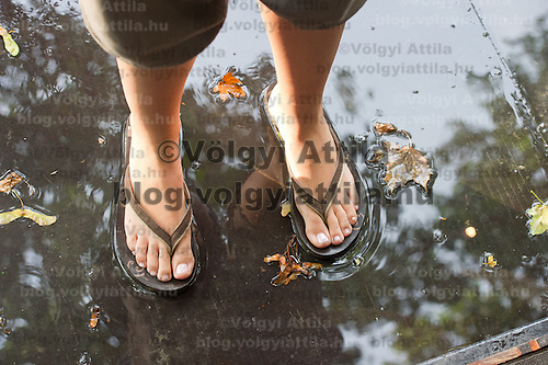 A participant stands in water after a rain fall on Sziget festival held in Budapest, Hungary on August 07, 2011. ATTILA VOLGYI
