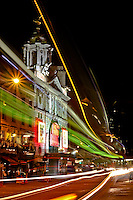 Light trails across the Victoria Palace Theatre at night