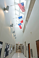 United States, French and Texas flags in CFAN Hallway