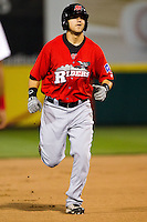 Michael Bianucci (33) of the Frisco RoughRiders rounds the bases after hitting a home run in the top of the fourth during a game against the Springfield Cardinals on April 14, 2011 at Hammons Field in Springfield, Missouri.  Photo By David Welker/Four Seam Images.