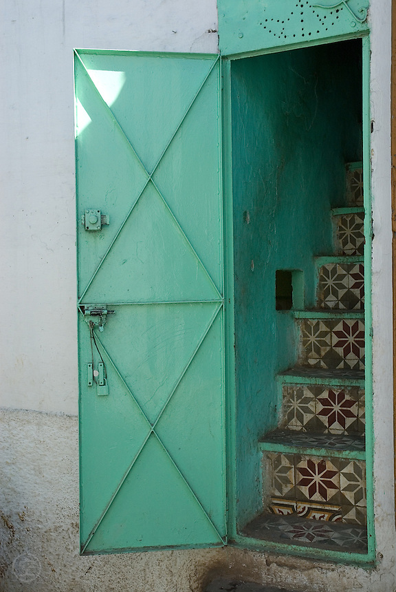 A tiled staircase leading into a house in Sefrou, Morocco.