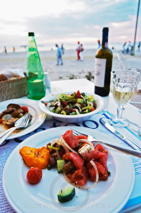 Dinner at a waterfront restaurant. Greek salad. Seafood restaurant at Macedonia Palace Hotel. Thessaloniki, Macedonia, Greece