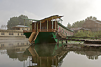 The Butterfly Houseboat is unique; it was designed and built by a German designer, an Irish architect and the owner, Mr Ali Baktoo's father. The windows are designed like lotus flowers and the dining room suit is mother of pearl. Everything on the boat is sourced from different areas of India. The bedrooms are themed, one bed is a lotus leaf, another a peacock, but the walkway is rotten and the western tourists no longer come.
