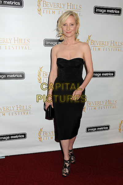 Anne Heche.12th Annual Beverly Hills Film Festival Opening Night held at the AMPAS Samuel Goldwyn Theater, Beverly Hills, California, USA..April 25th, 2012.full length black dress strapless clutch bag .CAP/ADM/BP.©Byron Purvis/AdMedia/Capital Pictures.
