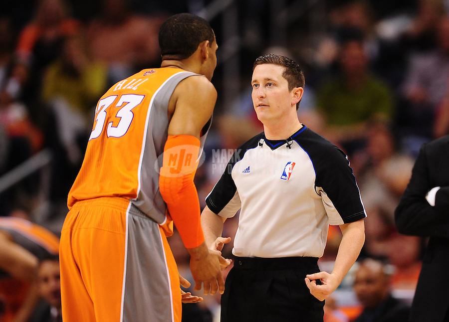 Mar. 25, 2011; Phoenix, AZ, USA; NBA referee Nick Buchert (right) talks with Phoenix Suns forward Grant Hill against the New Orleans Hornets at the US Airways Center. The Hornets defeated the Suns 106-100. Mandatory Credit: Mark J. Rebilas-USA TODAY Sports