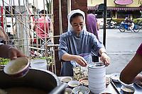 Sister Getrude is assigned to distribute free warm meals to the passers by in front of the hospital. She also coordinate the kitchen of the hospital. The first days that followed the typhoon, it was very hard to find food and clean water. <br /> <br /> Soeur Gertrude distribue des repas chauds gratuits aux passants devant l'h&ocirc;pital. Elle coordonne aussi la cuisine de l'h&ocirc;pital. Les premiers jours qui ont suivi l'ouragan, il &eacute;tait tr&egrave;s difficile de trouver de la nourriture et de l'eau propre.
