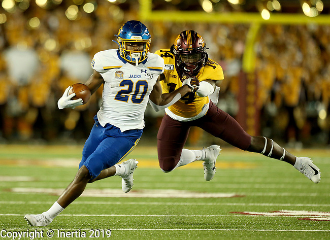 MINNEAPOLIS, MN - AUGUST 29: Pierre Strong, Jr. #20 from South Dakota State University looks to slip the grasp of Braelen Oliver #14 from the University of Minnesota during their game Thursday night at TCF Bank Stadium in Minneapolis, MN. (Photo by Dave Eggen/Inertia)