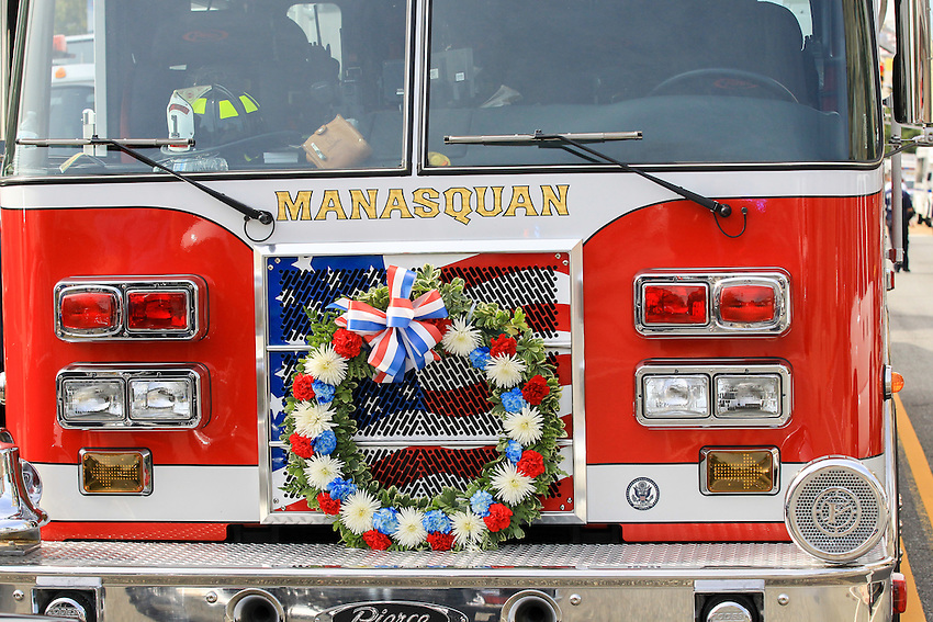 Manasquan tower ladder truck outside the funeral for Manasquan volunteer firefighter Dan McCann at St. Cecilia's Church in Kearny. McCann, a firefighter EMT with more than 25 years experience, died last week after a fire department training exercise.  9/21/16  (Andrew Mills | NJ Advance Media for NJ.com)