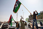 Mcc0030300 . Sunday Telegraph..Celebrating rebel fighters in the town of Ajdabiyah after Libyan government forces retreated due to repeated attacks from NATO airstrikes...Ajdabiyah 26 March 2011