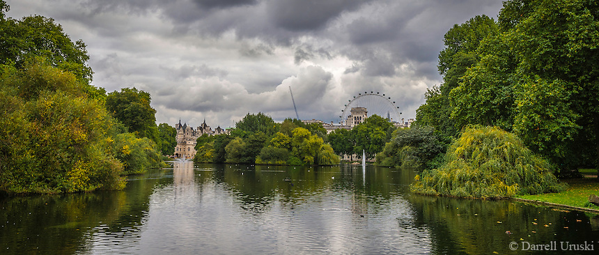 Fall Scenic of the London Eye as viewed from St James Park, in London, England. The water in the lake revealed the reflections of the trees that lined the park along the waters edge.