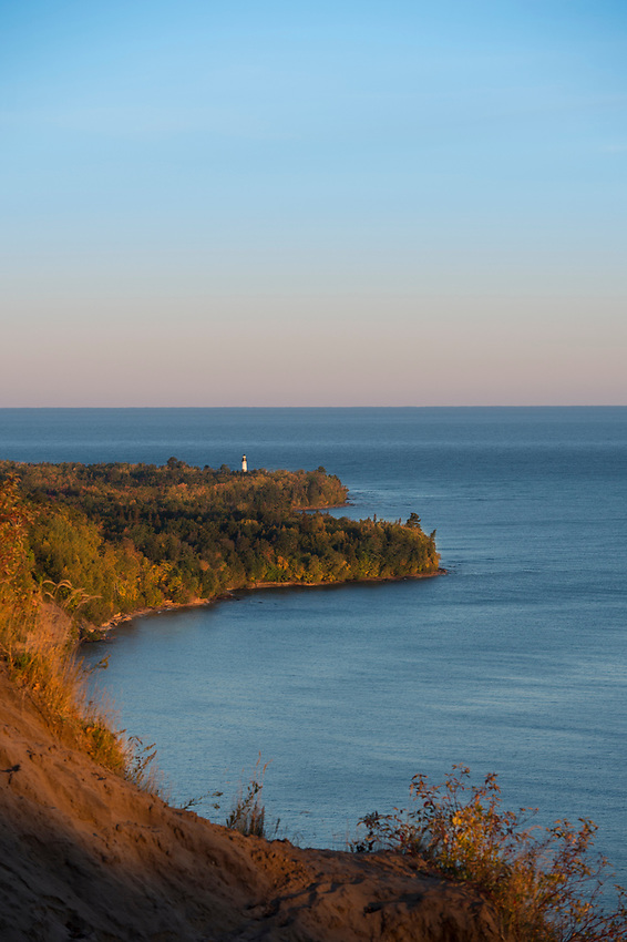 Fall color at AuSable Point Lighthouse in Pictured Rocks National Lakeshore on Michigan's Upper Peninsula.