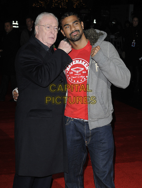 SIR MICHAEL CAINE & DAVID HAYE.attending the European Premiere of 'Harry Brown' at the Odeon Leicester Square, London, England, UK, November 10th 2009. .half length black coat red t-shirt grey gray hoodie pose boxer glasses goatee facial hair hands fists pose .CAP/CAN.©Can Nguyen/Capital Pictures
