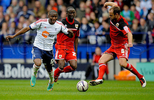 20.10.2012 Bolton, England.Benik Afobe of Bolton  and Louis Carey of Bristol City   in action during the Championship game between Bolton Wanderers and Bristol City from the Reebok Stadium.