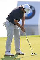 Alexander Levy (FRA) putts on the 9th green during Sunday's Final Round of the 2014 BMW Masters held at Lake Malaren, Shanghai, China. 2nd November 2014.<br /> Picture: Eoin Clarke www.golffile.ie