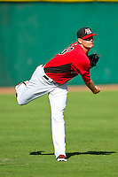 Hickory Crawdads starting pitcher Connor Sadzeck (19) warms up in the outfield prior to the game against the Kannapolis Intimidators at L.P. Frans Stadium on May 25, 2013 in Hickory, North Carolina.  The Crawdads defeated the Intimidators 14-3.  (Brian Westerholt/Four Seam Images)