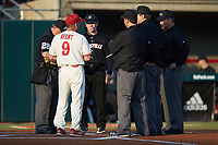 North Carolina State Wolfpack head coach Elliott Avent (9) meets with Louisville Cardinals head coach Dan McDonnell and the umpiring crew prior to their ACC baseball game at Doak Field at Dail Park on March 24, 2017 in Raleigh, North Carolina. The Wolfpack defeated the Cardinals 3-1. (Brian Westerholt/Four Seam Images)
