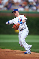 Chicago Cubs second baseman Chris Coghlan (8) throws to first during a game against the Milwaukee Brewers on August 13, 2015 at Wrigley Field in Chicago, Illinois.  Chicago defeated Milwaukee 9-2.  (Mike Janes/Four Seam Images)