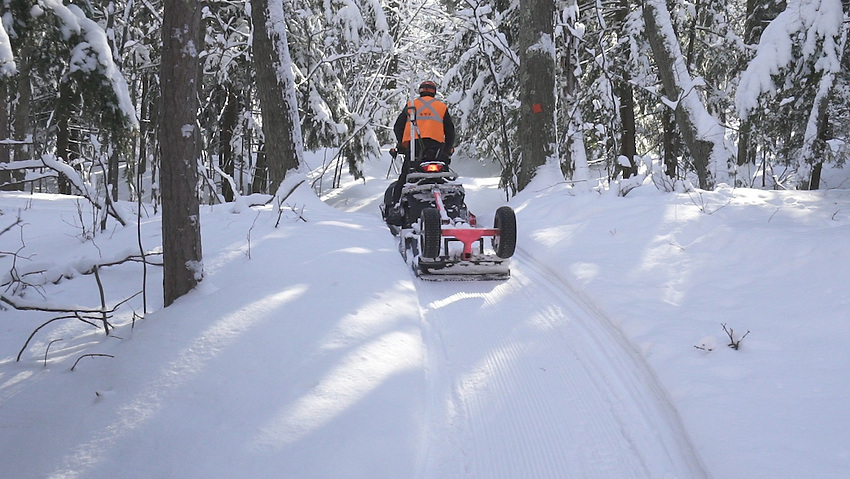VIDEO FRAME GRAB--Winter fat bike singletrack grooming operations of the Noquemanon Trails Network's Snow Bike Route in Marquette, Michigan.