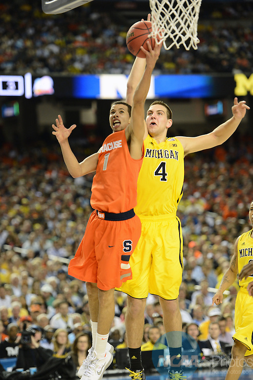 06 Apr 2013: Mitch McGary (4) of the University of Michigan defends against Michael Carter-Williams (1) of Syracuse University in the semifinal game of the 2013 NCAA Men's Division I Basketball Championship Final Four held at the Georgia Dome in Atlanta, GA. Peter Lockley/NCAA Photos
