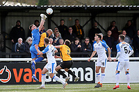 Havant and Waterlooville goalkeeper, Ben Dudzinski, punches the ball clear under pressure from Maidstone's Elliott Romain during Maidstone United vs Havant and Waterlooville, Vanarama National League Football at the Gallagher Stadium on 9th March 2019