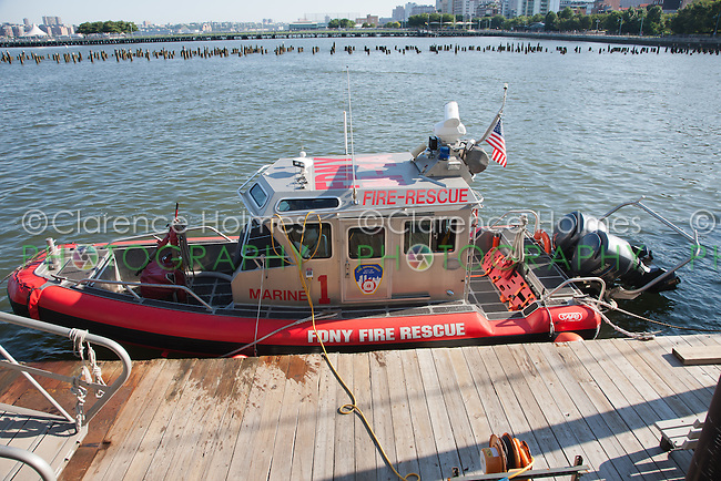 FDNY Marine 1 Alpha (M-1A), a small rapid response fire rescue boat, moored in its berth at Pier 40 on the Hudson River.
