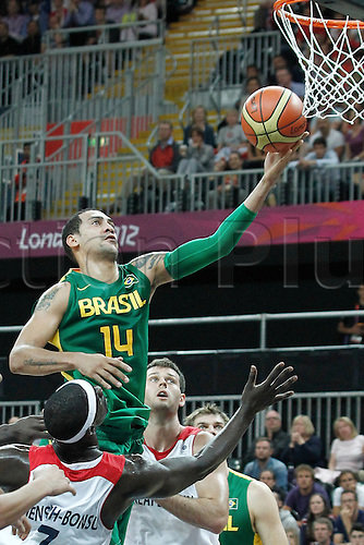 31.07.2012. London, England. 2012 Olympic  Basketball tournament.  Brazil Marquinhos Vieira Sousa goes for the layup during 67-62 Team Brazil victory over Team Great Britain, during the men's basketball preliminary, at the Basketball Arena, in London, Great Britain.