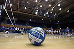 DURHAM, NC - SEPTEMBER 01: A volleyball sits on the court while the teams warmup in the background. The Northwestern University Wildcats played the University of South Carolina Gamecocks on September 1, 2017 at Cameron Indoor Stadium in Durham, NC in a Division I women's college volleyball match. Northwestern won 3-1 (13-25, 25-18, 25-18, 25-19).