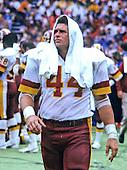 Washington Redskins running back John Riggins (44) walks on the sideline during the game against the Detroit Lions at RFK Stadium in Washington, D.C. on October 13, 1985.  The Redskins won the game 24 - 3..Credit: Howard L. Sachs / CNP