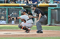 Guillermo Quiroz (41) of the Fresno Grizzlies behind the plate with home plate umpire Brian Reilly against the Salt Lake Bees at Smith's Ballpark on May 25, 2014 in Salt Lake City, Utah.  (Stephen Smith/Four Seam Images)