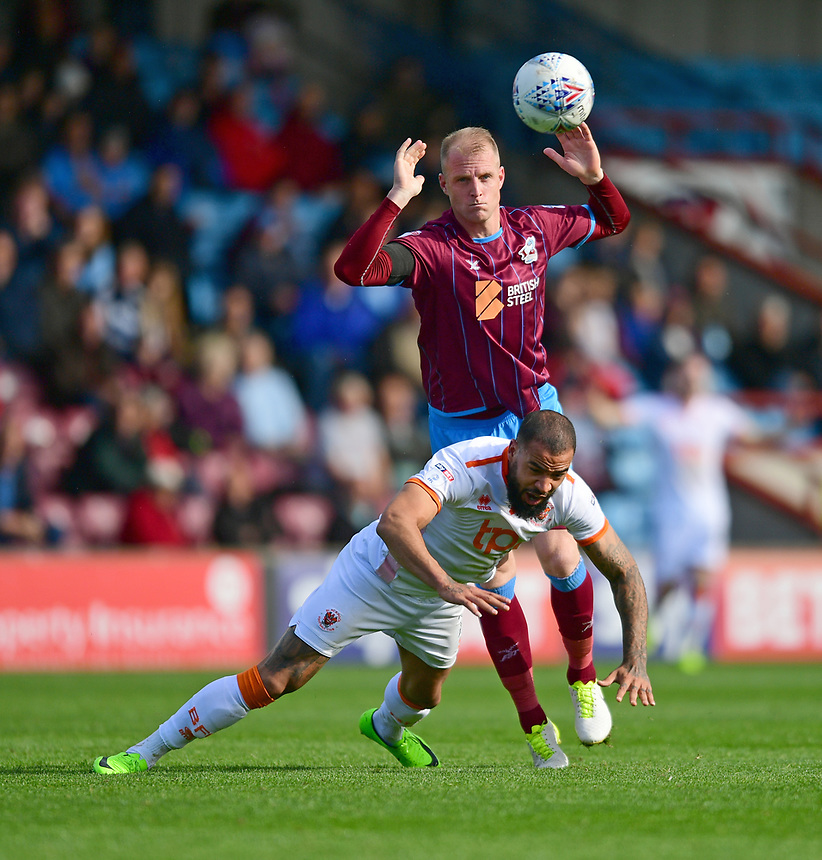Blackpool's Kyle Vassell is fouled by Scunthorpe United's Neal Bishop<br /> <br /> Photographer Chris Vaughan/CameraSport<br /> <br /> The EFL Sky Bet League One - Scunthorpe United v Blackpool - Saturday 9th September 2017 - Glanford Park - Scunthorpe<br /> <br /> World Copyright &copy; 2017 CameraSport. All rights reserved. 43 Linden Ave. Countesthorpe. Leicester. England. LE8 5PG - Tel: +44 (0) 116 277 4147 - admin@camerasport.com - www.camerasport.com