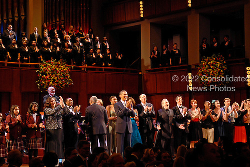 Washington, DC - March 8, 2009 -- United States President Barack Obama joins performers on stage to lead in singing 'Happy Birthday' to Senator Ted Kennedy (Democrat- Massachusetts) at a musical tribute to celebrate Kennedy's birthday at the Kennedy Center in Washington, DC., USA, on Sunday, 08 March 2009. .Credit: Chris Usher - Pool via CNP