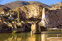 Remains of medieval Artukid Old Tigris Bridge – Built in 1116 by Artukid Fahrettin Karaaslan, the biggest in Anatolia at the time, with the old town Hasankeyf and its ruins on the cliffs abover the river Tigris. The minaret is of the El Rizk Mosque built 1409.  Turkey. 7