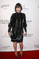 BEVERLY HILLS, CA - OCTOBER 13: Milla Jovovich at the What Goes Around Comes Around Beverly Hills Opening on October 13, 2016 in Beverly Hills, California. Credit: David Edwards/MediaPunch