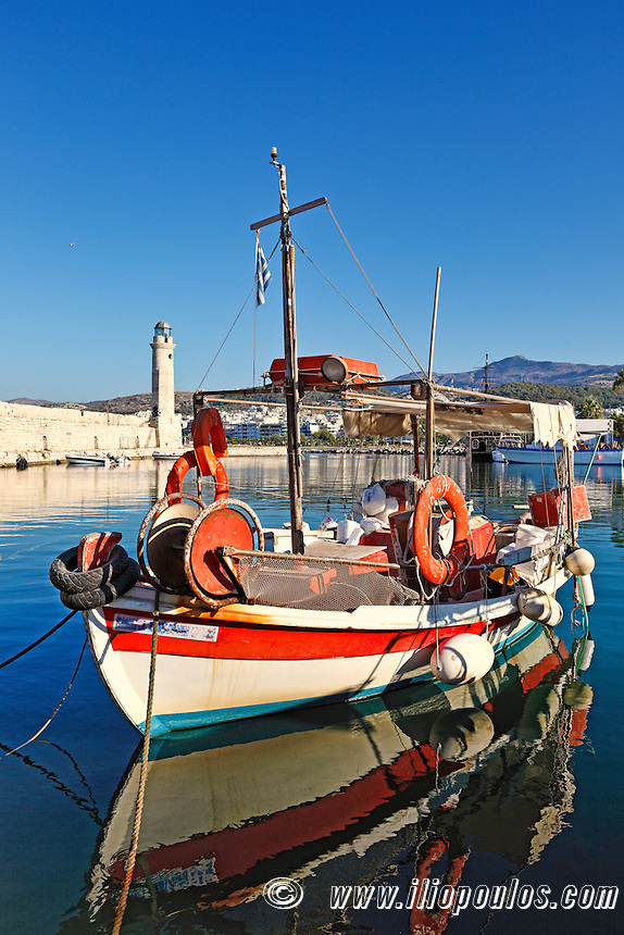 A fishing boat at Rethymno's Venetian Harbour in Crete, Greece